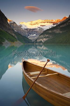 canoe on lake louise at sunrise