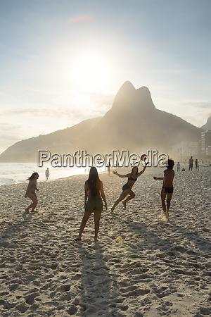people playing altinha football on ipanema
