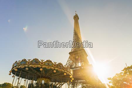 eiffel tower with historic carousel paris