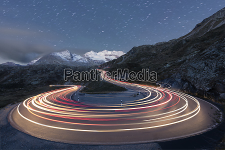 star trail and lights of car