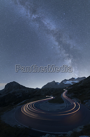 milky way and lights of car