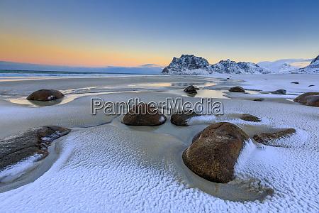 dawn illuminates the rocks shaped by