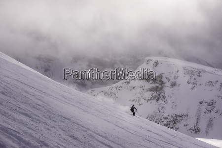 skier in the mountains on a