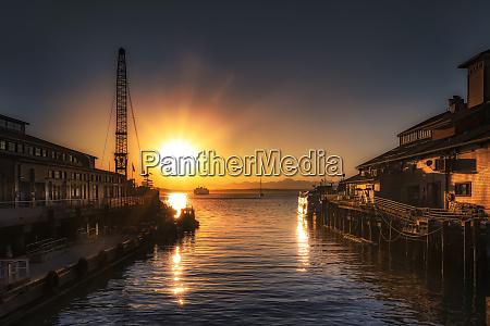 stunning sunset over pier 55 in
