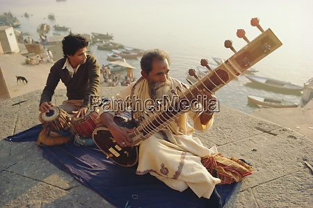 musicians playing the sitar and tabla