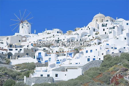 stuccoed houses and windmill oia santorini