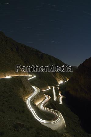 car light trails at night winding