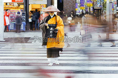 shinto monk in traditional dress collecting