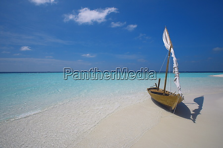 traditional dhoni on the beach maldives