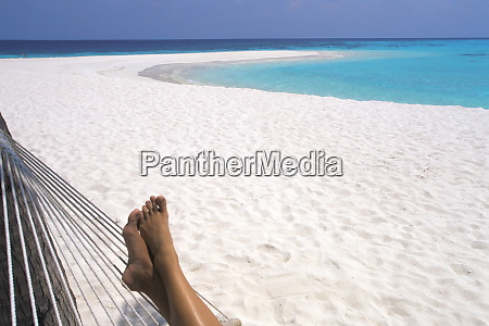 woman barefoot in hammock maldives indian