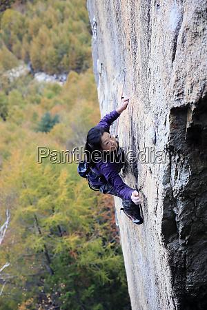 a woman rock climbing at ogawayama