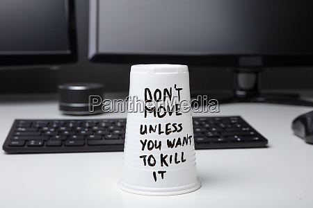 message on disposable glass over desk
