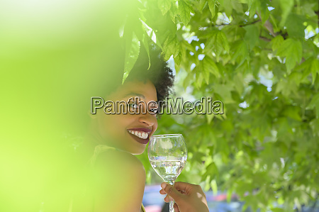 smiling young woman with glass of