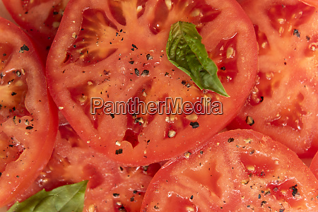 sliced tomatoes with basil and pepper