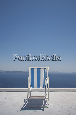 striped deck chair on balcony by