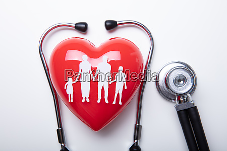 family cut out over red heart