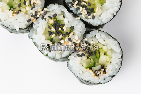 sushi with cucumber and sesame seeds