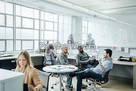 men having meeting in office