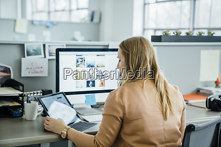 woman using digital tablet and computer