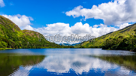 photography of lake and mountain with