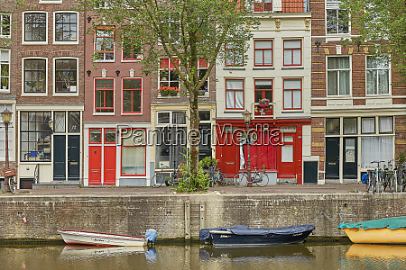 amsterdam canal with typical dutch houses