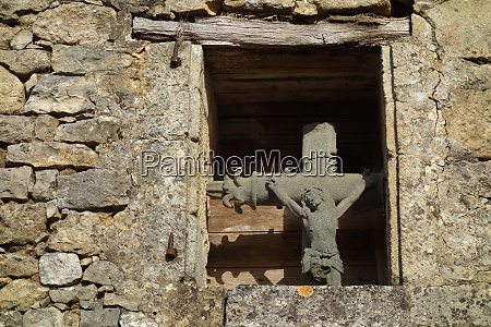 sprout window with crucifix in domme