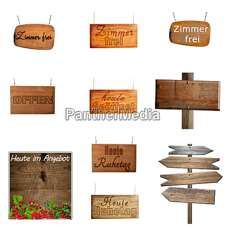 set of hanging wooden signs on