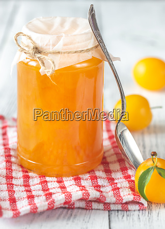 glass jar of plum jam