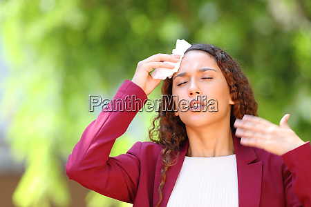 stressed mixed race woman suffering heat
