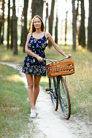 happy girl with a bicycle in
