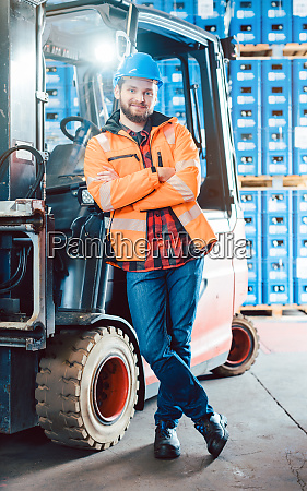 worker in logistics distribution center with