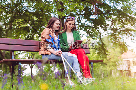 two friends in a park one