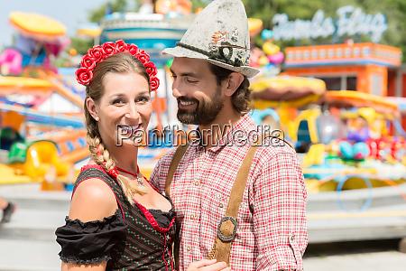 couple having fun on bavarian fair