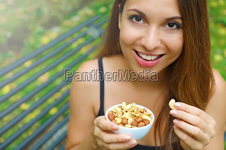 close up smiling girl eating snack