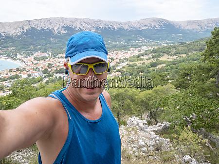 selfie of cool trailrunning man in