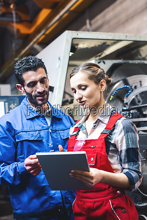 woman and man manufacturing worker in
