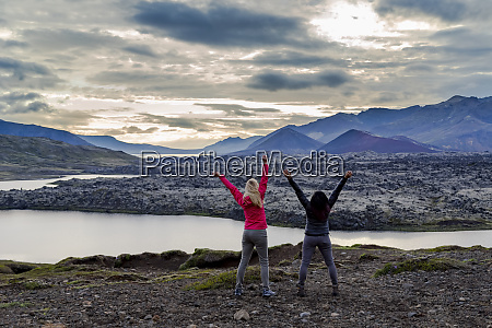two female travellers celebrate their hike