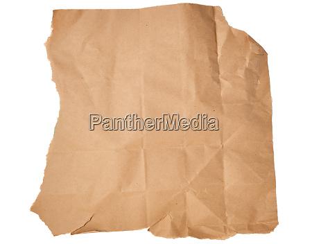 torn piece of brown craft paper