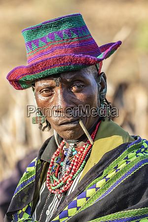 hamer man wearing a colourful hat