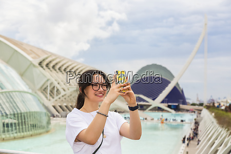 young female tourist at city of
