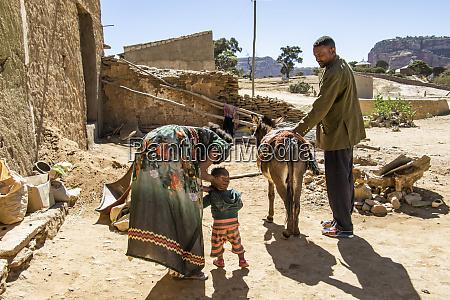 ethiopian family and their donkey dugem