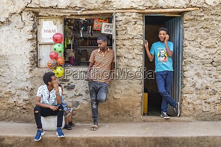 young ethiopian men outside a shop