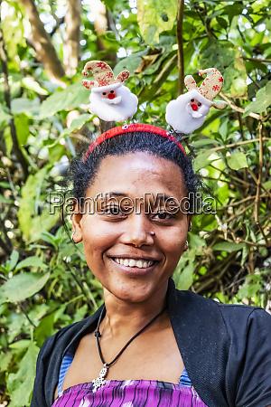 ethiopian woman wearing a christmas headband