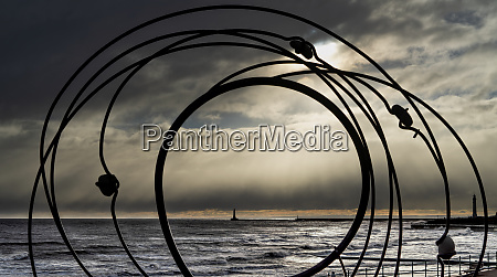 silhouette of a sculpture and roker