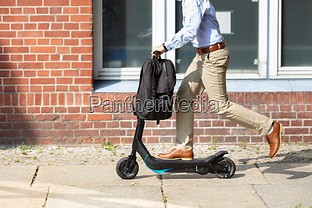 young man riding an electric scooter