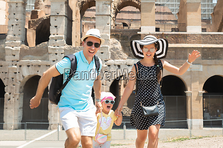 young, family, running, in, front, of - 27289336