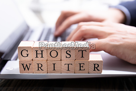 ghostwriter wooden block on computer keyboard