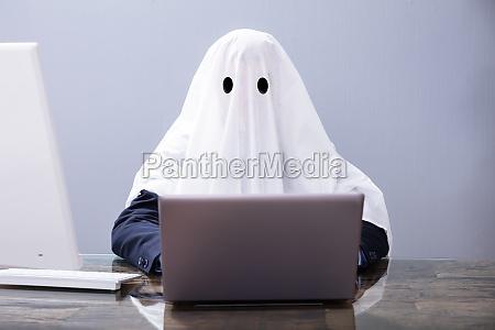 ghostwriter writing article on laptop