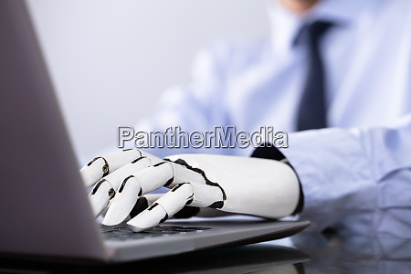man with prosthetic hand working on