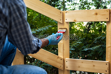 craftsman at work on a wooden